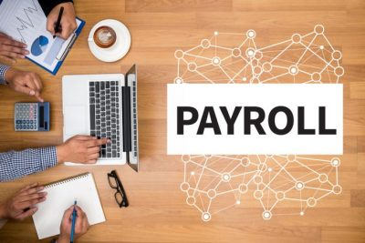 Single Touch Payroll title with overhead view of table with computer